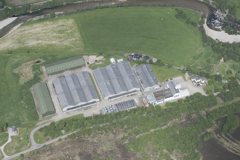 Oblique aerial view of Tomintoul - Glenlivet Distillery, looking NNW.