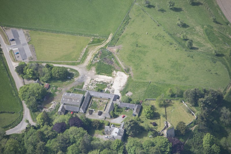 Oblique aerial view of Drumin Castle and Drumin Farmstead, looking WSW.