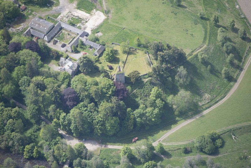 Oblique aerial view of Drumin Castle and Drumin Farmstead, looking SW.