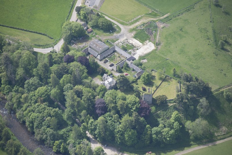 Oblique aerial view of Drumin Castle and Drumin Farmstead, looking SSW.