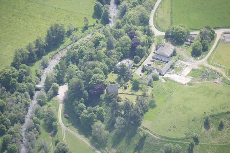 Oblique aerial view of Drumin Castle and Drumin Farmstead, looking SE.