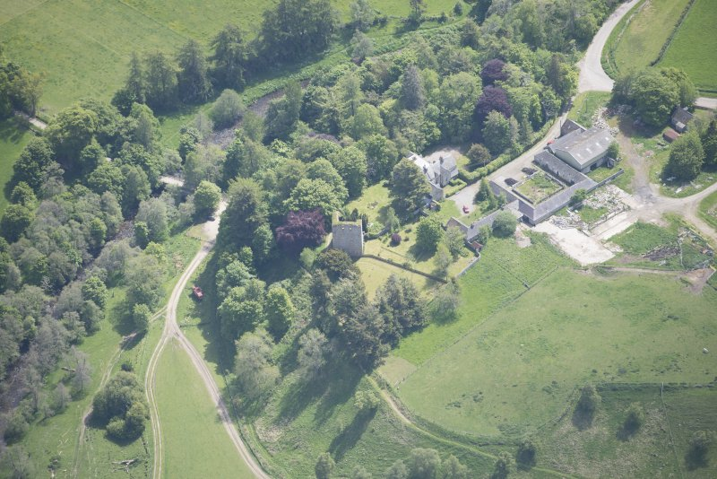 Oblique aerial view of Drumin Castle and Drumin Farmstead, looking ESE.