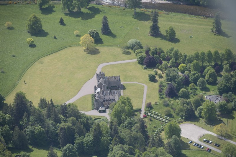 Oblique aerial view of Ballindalloch Castle, looking SW.