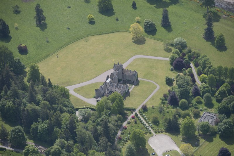 Oblique aerial view of Ballindalloch Castle, looking S.