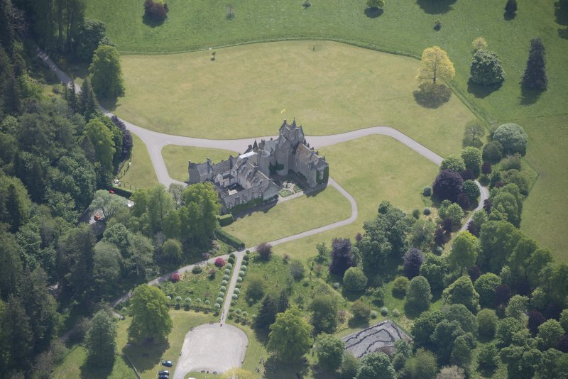 Oblique aerial view of Ballindalloch Castle, looking SSE.