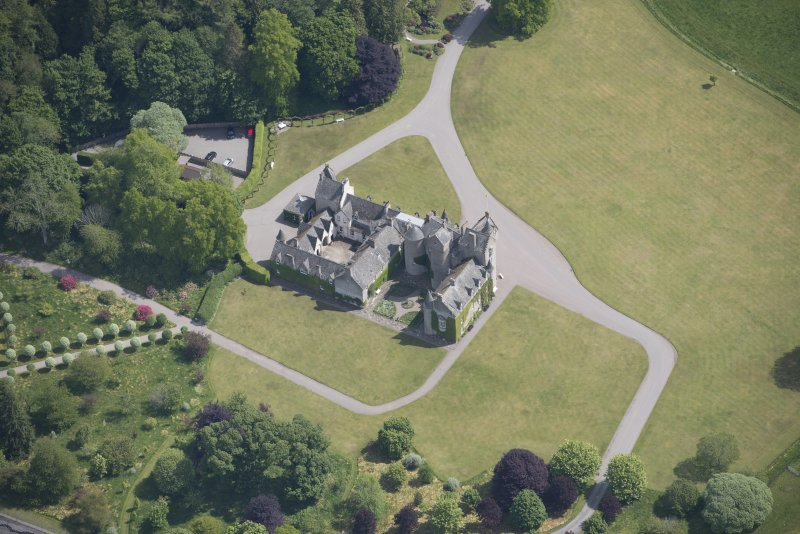 Oblique aerial view of Ballindalloch Castle, looking E.