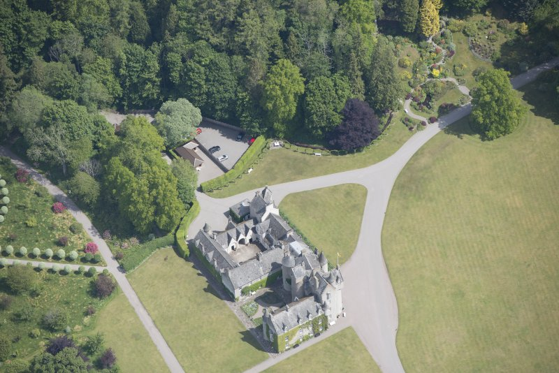 Oblique aerial view of Ballindalloch Castle, looking NE.