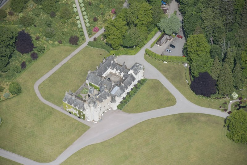 Oblique aerial view of Ballindalloch Castle, looking N.