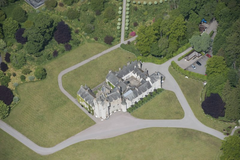 Oblique aerial view of Ballindalloch Castle, looking NW.