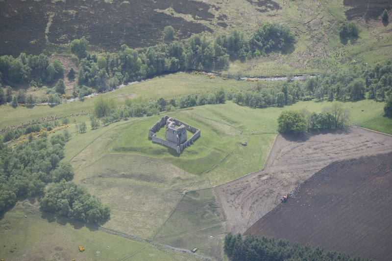 Oblique aerial view of Auchindoun Castle, looking SSE.