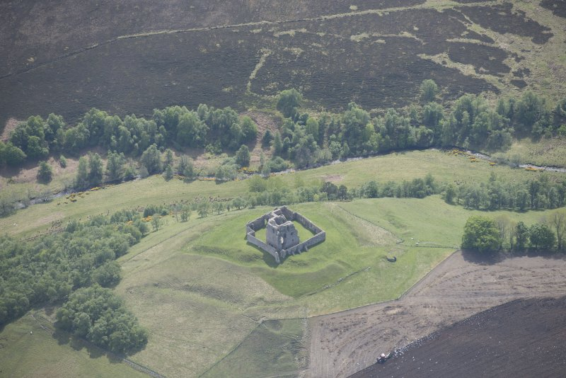 Oblique aerial view of Auchindoun Castle, looking SE.
