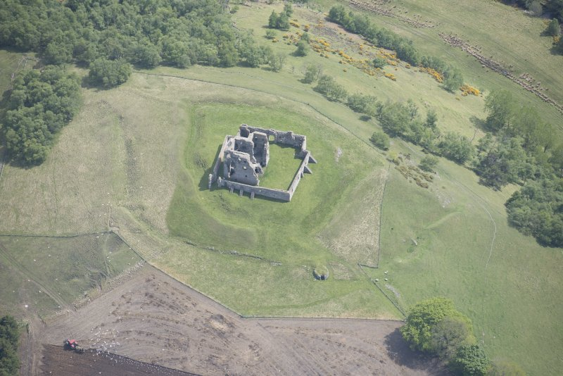 Oblique aerial view of Auchindoun Castle, looking E.