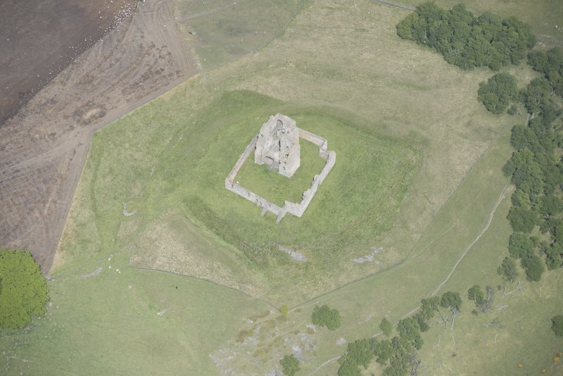 Oblique aerial view of Auchindoun Castle, looking NE.