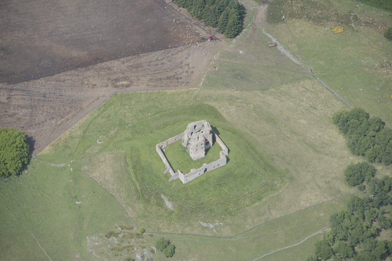 Oblique aerial view of Auchindoun Castle, looking NNW.