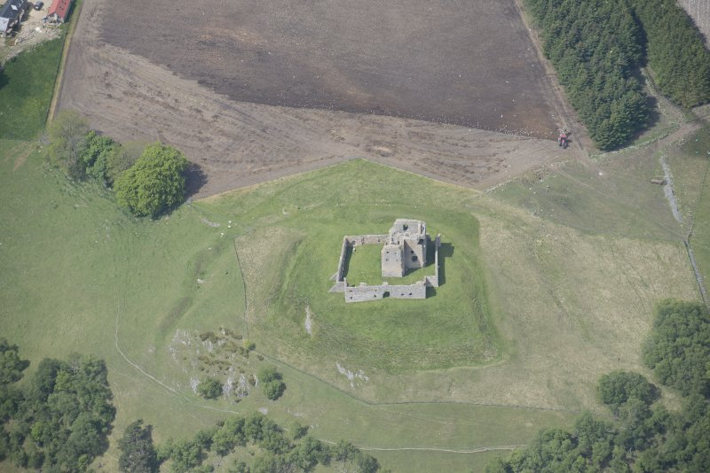 Oblique aerial view of Auchindoun Castle, looking NW.
