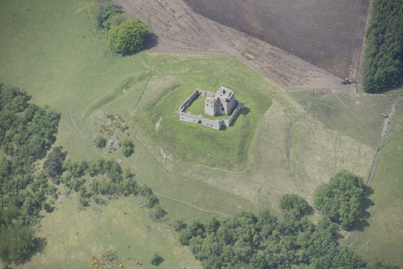 Oblique aerial view of Auchindoun Castle, looking W.