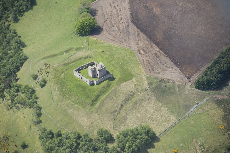 Oblique aerial view of Auchindoun Castle, looking SW.