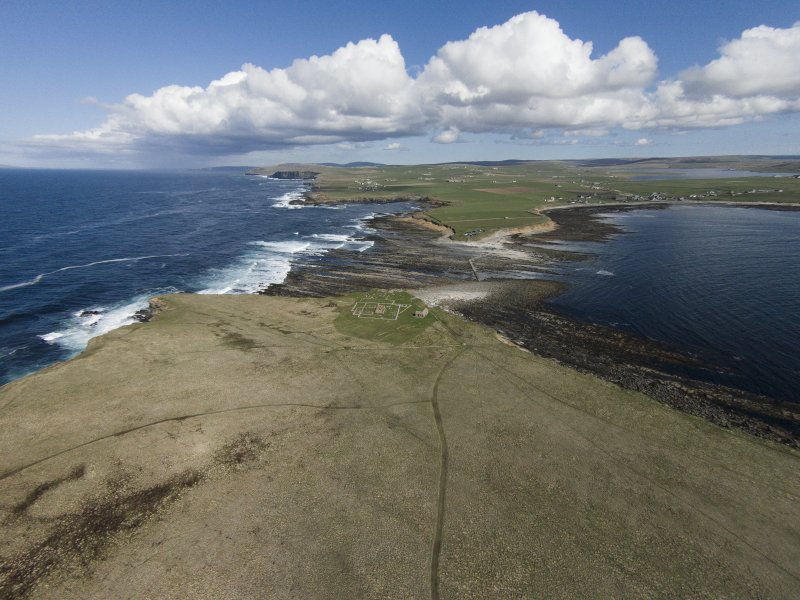 Oblique aerial view of the chapel and settlement at Brough of Birsay, looking ESE.
