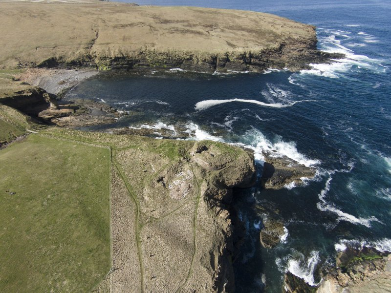 Oblique aerial view of the Broch of Borwick, Yesnaby, looking SW.