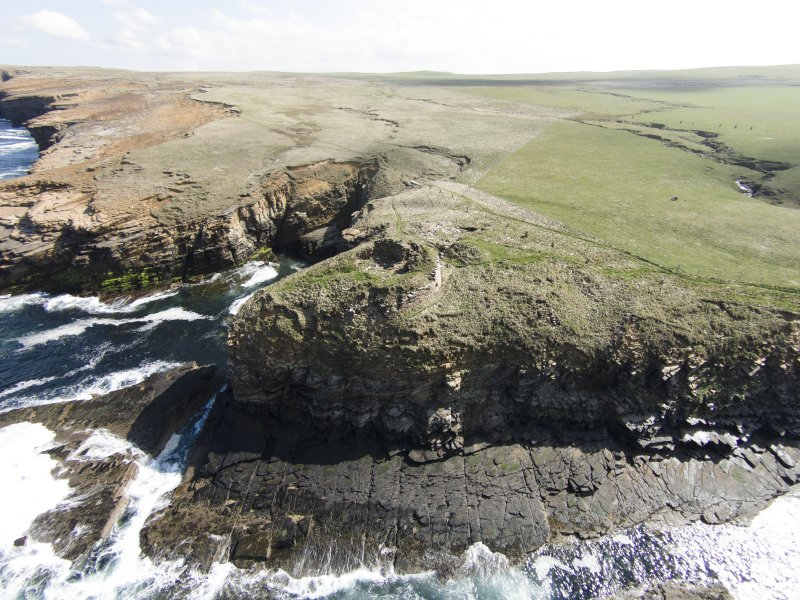 Oblique aerial view of the Broch of Borwick, Yesnaby, looking E.