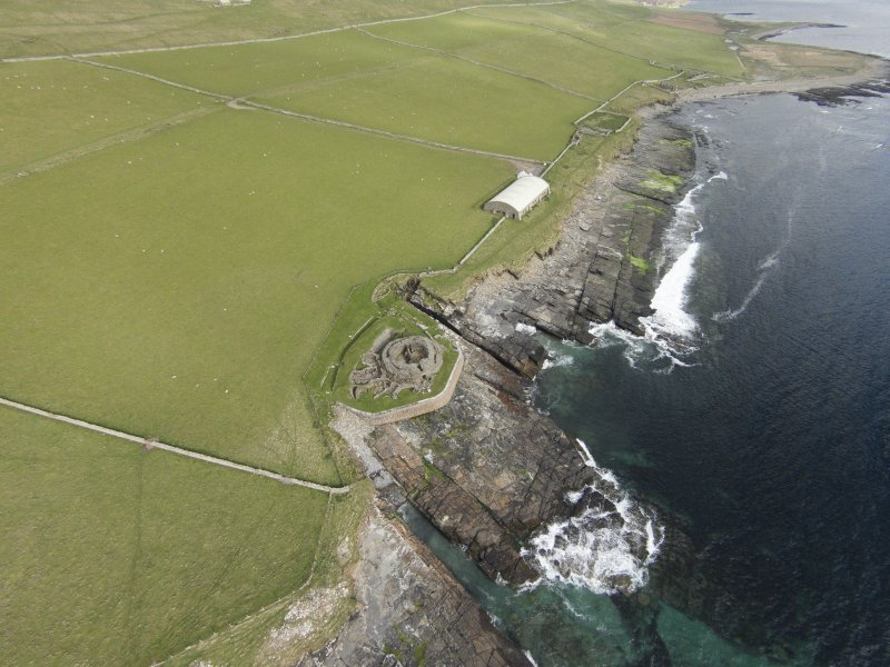 Oblique aerial view of Mid Howe broch, looking SE.