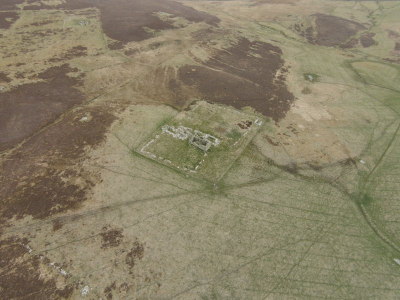 Oblique aerial view of the farmstead at Tafts, looking ESE.