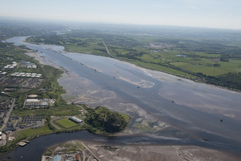General oblique aerial view of the River Clyde centred on the Lang Dyke sea defences with Dumbarton FC and Dumbarton Castle in the foreground, looking SE.