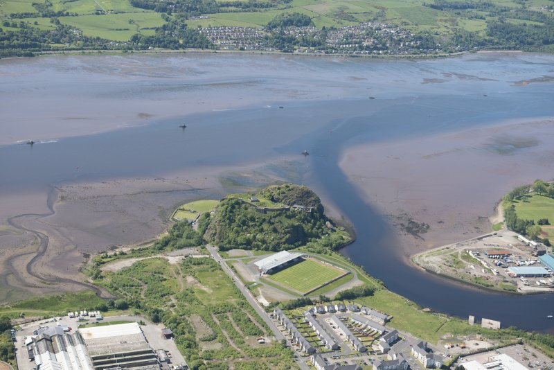Oblique aerial view of Dumbarton Castle, Strathclyde Homes Stadium and Lang Dyke sea defences, looking SSW.