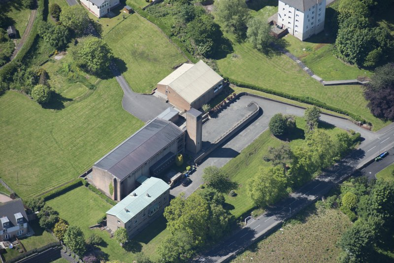Oblique aerial view of the Holy Family Roman Catholic Church, looking SW.