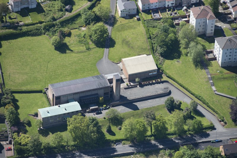 Oblique aerial view of the Holy Family Roman Catholic Church, looking SSW.