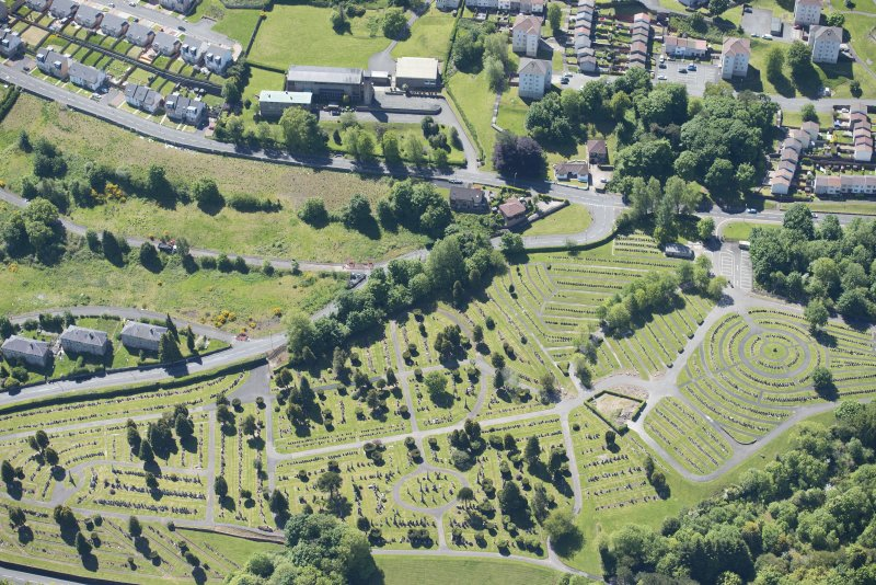 Oblique aerial view of the Holy Family Roman Catholic Church and Port Glasgow Cemetery, looking S.