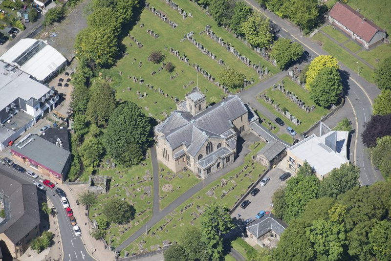 Oblique aerial view of New Kilpatrick Parish Church, looking NW.