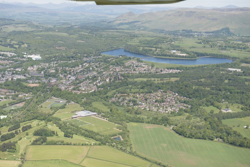 Oblique aerial view of Milngavie, Craigmaddie and Mugdock Reservoirs, looking N.