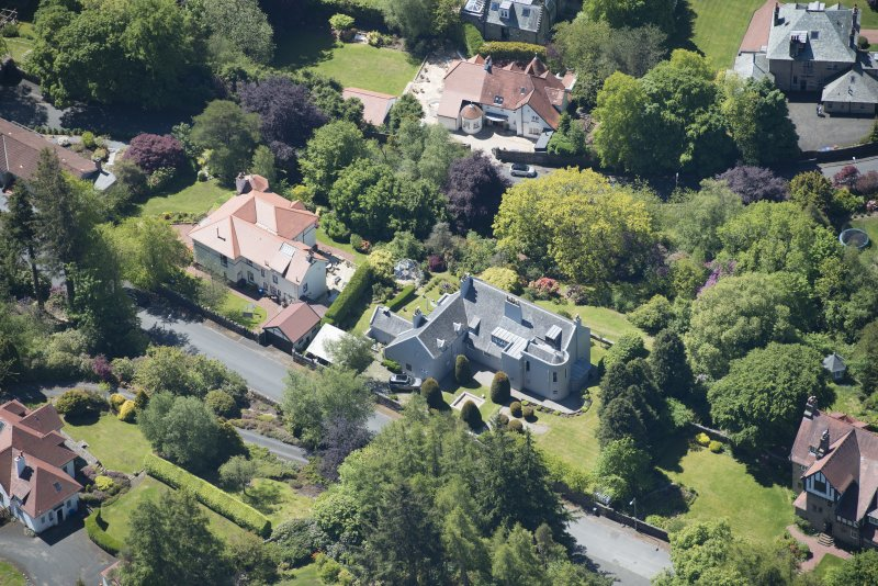Oblique aerial view of Windyhill House, looking SW.