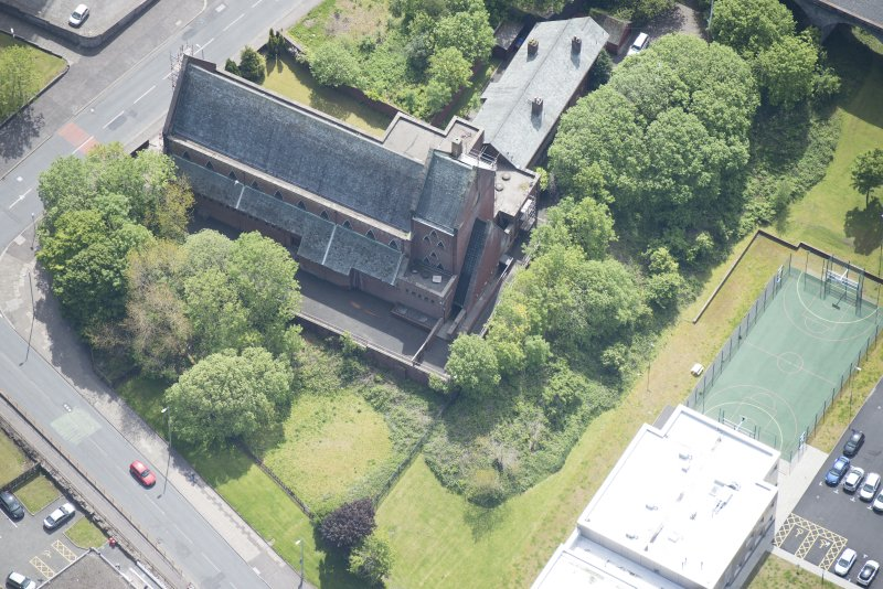 Oblique aerial view of St Lawrence's Roman Catholic Church and Presbytery, looking S.