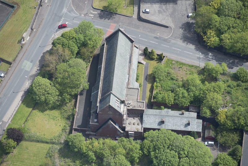 Oblique aerial view of St Lawrence's Roman Catholic Church and Presbytery, looking ESE.