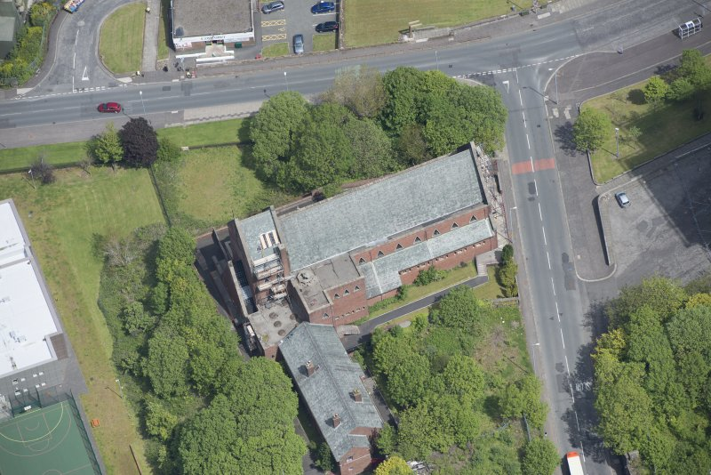 Oblique aerial view of St Lawrence's Roman Catholic Church and Presbytery, looking NE.