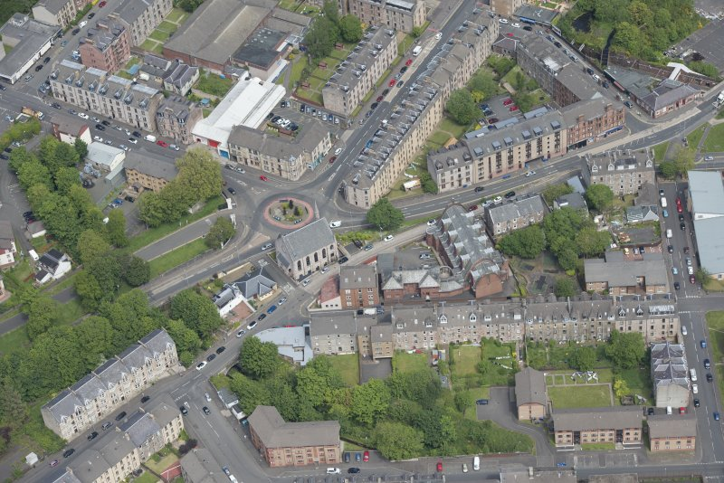 Oblique aerial view of Orangefield Baptist Church and St Patrick's Roman Catholic Church, looking NNE.