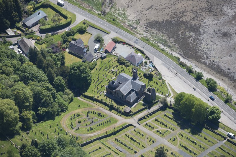 Oblique aerial view of Kilmun Cemetery, St Munn's Church and Collegiate Church of St Mun, looking SE.