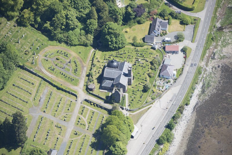 Oblique aerial view of Kilmun Cemetery, St Munn's Church, Collegiate Church of St Mun and St Munn's Church and Churchyard, looking ESE.