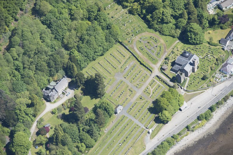 Oblique aerial view of Kilmun Cemetery, St Munn's Church, Collegiate Church of St Mun and St Munn's Church and Churchyard, looking ENE.