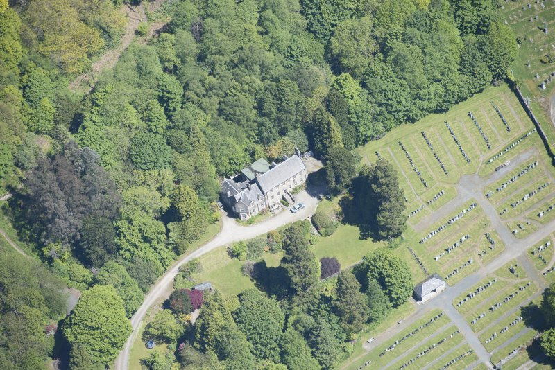 Oblique aerial view of Old Kilmun House and Kilmun Cemetery, looking NE.