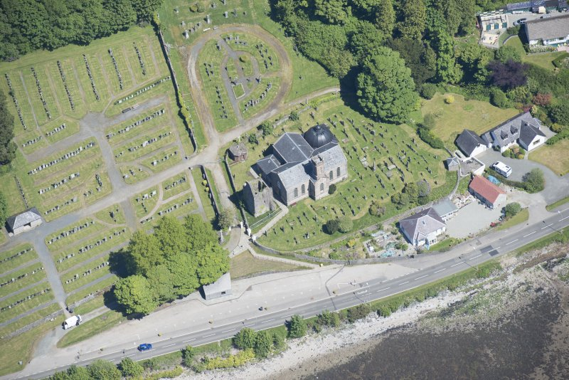 Oblique aerial view of Kilmun Cemetery, St Munn's Church, Collegiate Church of St Mun and St Munn's Church and Churchyard, looking NE.