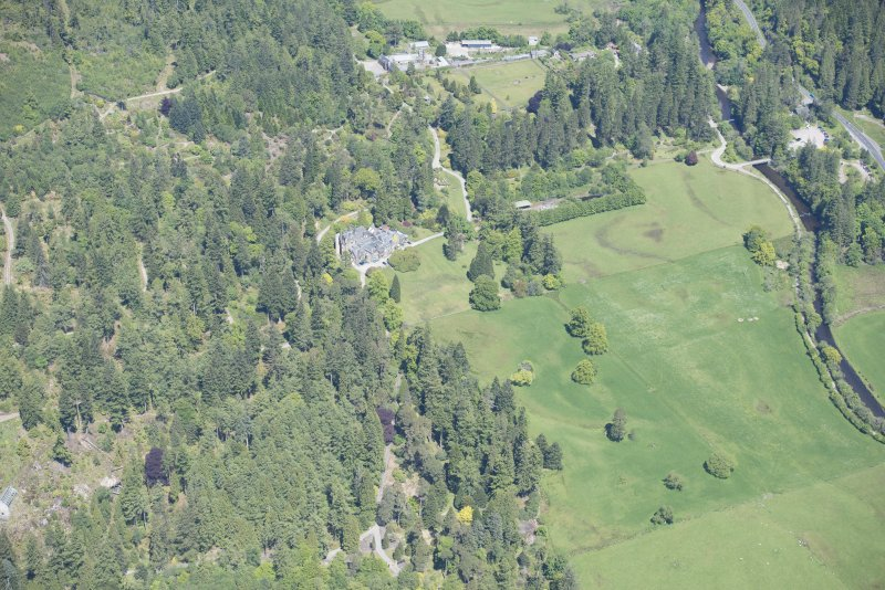 Oblique aerial view of Benmore House and entrance gates, looking N.