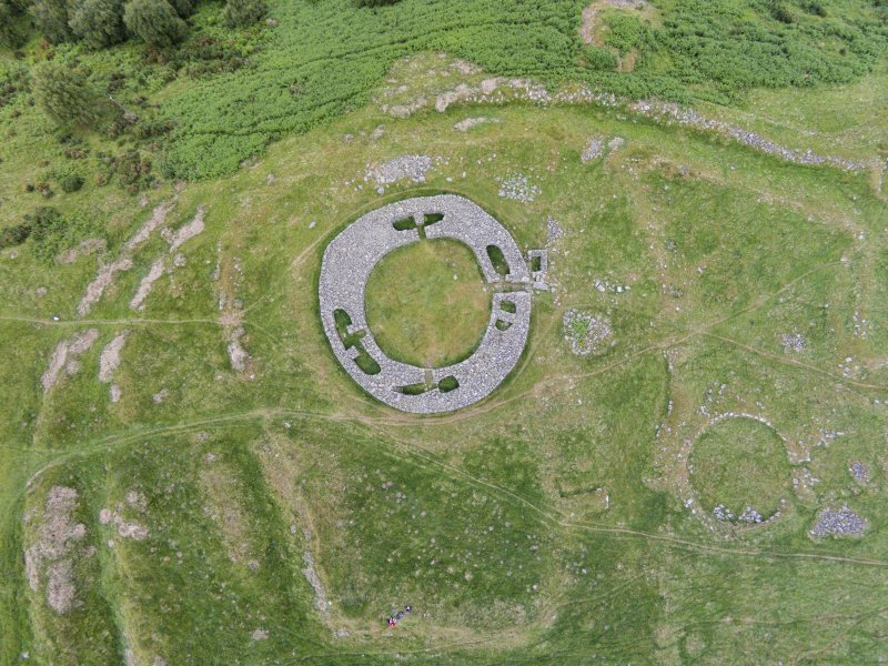 Oblique aerial view of Edin's Hall centred on the broch, looking N.