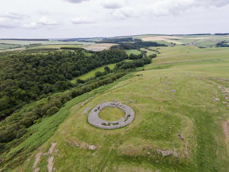 Oblique aerial view of Edin's Hall centred on the broch, looking NE.