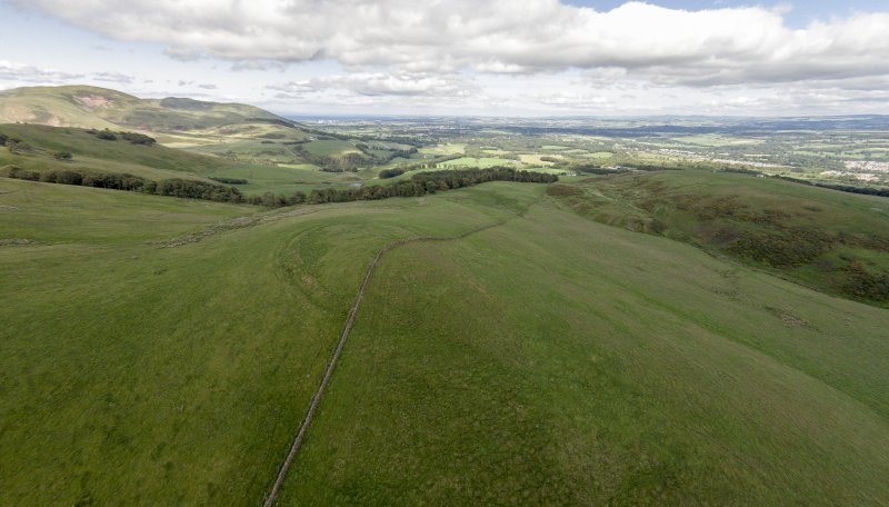Oblique aerial view of Turnhouse Hill fort looking east.