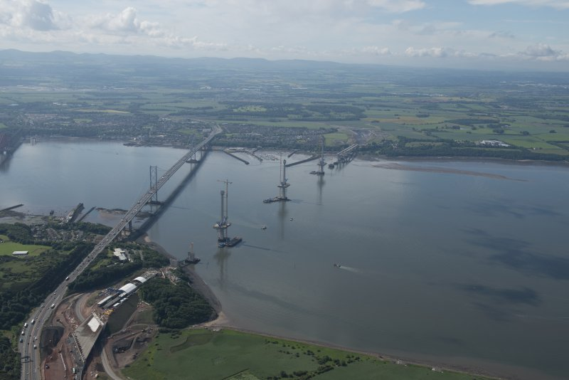 Oblique aerial view of the roadworks and construction of the Queensferry Crossing and Forth Road Bridge, looking SE.