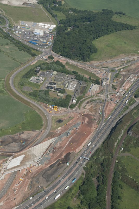 Oblique aerial view of the roadworks on the north bank of the River Forth on the approach to the Queensferry Crossing, looking NW.