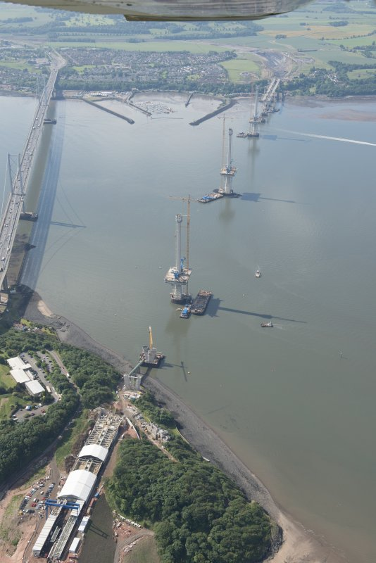 Oblique aerial view of the construction of the Queensferry Crossing and Forth Road Bridge, looking S.